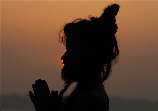 A sadhu, or Hindu holy man, prays after a dip in the River Ganges in Allahabad, India, Saturday, Sept. 25, 2010. Allahabad, at the confluence of the Rivers Ganges and Yamuna, is one of Hinduism?s holiest cities. &#40;AP Photo&#47;Rajesh Kumar Singh&#41; <span class=meta>(AP Photo&#47; Rajesh Kumar Singh)</span>
