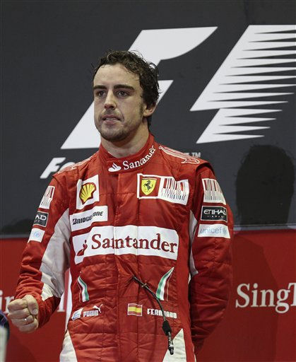 Ferrari Formula One driver Fernando Alonso of Spain celebrates on the podium after winning the Singapore Grand Prix on the Marina Bay City Circuit in Singapore, Sunday, Sept. 26, 2010. &#40;AP Photo&#47;Mark Baker&#41; <span class=meta>(AP Photo&#47; Mark Baker)</span>