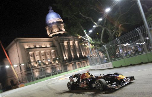 "<div class=""meta ""><span class=""caption-text "">Red Bull Formula One driver Sebastian Vettel of Germany drives past the Supreme Court building during the Singapore Grand Prix on the Marina Bay Circuit in Singapore on Sunday Sept. 26, 2010.(AP Photo/Wong Maye-E) (AP Photo/ Wong Maye-E)</span></div>"
