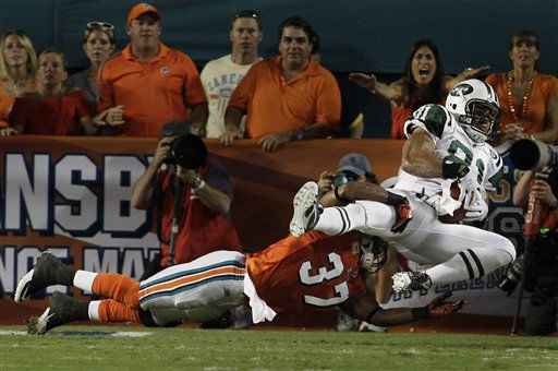 New York Jets tight end Dustin Keller, right, makes a catch for a touchdown as Miami Dolphins safety Yeremiah Bell defends during the first quarter of an NFL football game, Sunday, Sept. 26, 2010 in Miami.  <span class=meta>(AP Photo&#47; Lynne Sladky)</span>