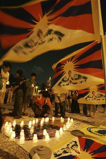 Tibetans living in Taiwan and supporters put candlelight around the Tibetan map at a prayer and candlelit vigil during a ceremony to mark the 1987 Lhasa Uprising in front of Chiang Kai-shek Memorial Hall, Monday, Sept. 27, 2010, in Taipei, Taiwan. &#40;AP Photo&#47;Chiang Ying-ying&#41; <span class=meta>(AP Photo&#47; Chiang Ying-ying)</span>