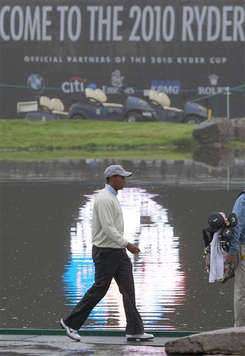 Tiger Woods of the United States team crosses a water feature on their way to a photocall before the 2010 Ryder Cup golf tournament in Newport, Wales, Tuesday, Sept. 28, 2010. The tournament starts Friday Oct. 1. <span class=meta>(Photo&#47;Jon Super)</span>