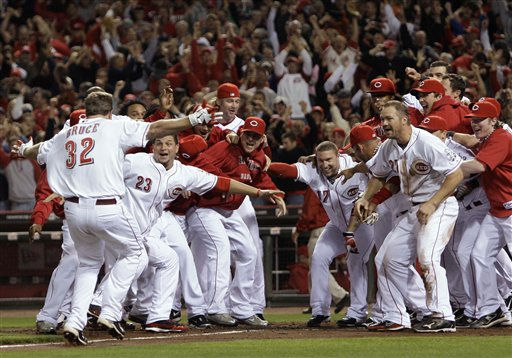 Cincinnati Reds&#39; Jay Bruce &#40;32&#41; is greeted at home plate after hitting a home run off Houston Astros relief pitcher Tim Bydak in the ninth inning of a baseball game, Tuesday, Sept. 28, 2010, in Cincinnati. Cincinnati clinched the NL Central with a 3-2 win.  <span class=meta>(AP Photo&#47; Al Behrman)</span>