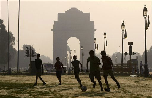Youths play soccer early in the morning near the India Gate in New Delhi, India, Friday, Oct. 1, 2010. New Delhi will host the Commonwealth Games, which are scheduled to begin on Sunday. &#40;AP Photo&#47;Eranga Jayawardena&#41; <span class=meta>(AP Photo&#47; Eranga Jayawardena)</span>