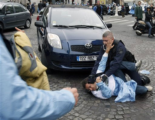 A French riot policeman, left, holds an anesthetist doctor who was demonstrating near the Elysee Palace in Paris, Friday, Oct. 1, 2010 on the ground. Hundreds of anesthetist doctors were protesting against the policy of the French Health Minister Roselyne Bachelot.&#40;AP Photo&#47;Remy de la Mauviniere&#41; <span class=meta>(AP Photo&#47; Remy de la Mauviniere)</span>