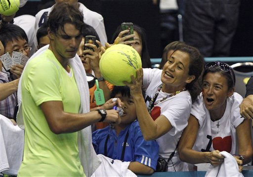 "<div class=""meta image-caption""><div class=""origin-logo origin-image ""><span></span></div><span class=""caption-text"">Fans seek autograph by Rafael Nadal of Spain after his loss to compatriot Guillermo Garcia-Lopez in their  semifinal match at the PTT Thailand Open tennis tournament in Bangkok, Thailand Saturday, Oct . 2, 2010. Top-ranked Nadal was defeated by 53rd-ranked Garcia-Lopez 2-6, 7-6, 6-3. (AP Photo/Wason wanichakorn) (AP Photo/ Wason Wanichakorn)</span></div>"