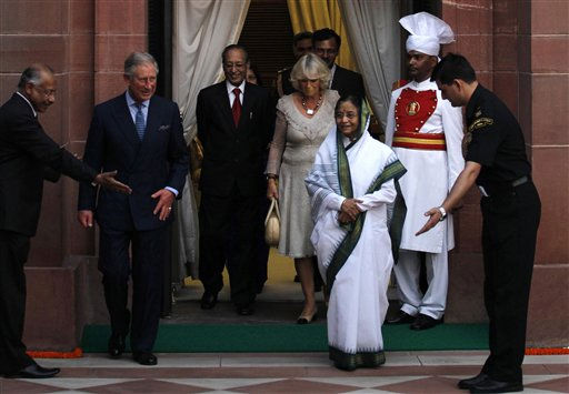 Officials gesture as Britain&#39;s Prince Charles, second left, and Camilla, Duchess of Cornwall, center, and Indian President Pratibha Patil, wearing white sari, walk out a door at the Indian Presidential Palace in New Delhi, India, Saturday, Oct. 2, 2010. Prince Charles is in India to attend the opening of the Commonwealth Games, scheduled for Sunday. &#40;AP Photo&#47;Saurabh Das&#41; <span class=meta>(AP Photo&#47; Saurabh Das)</span>