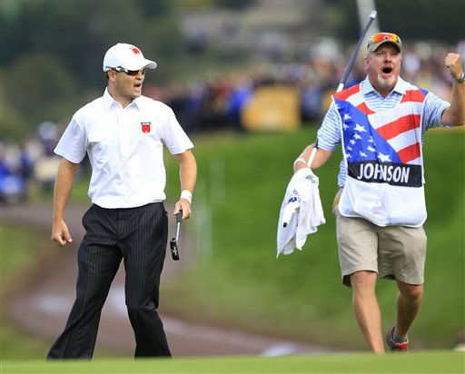 Zach Johnson, left, and his caddie Damon Green react on the 17th green after winning the hole on the second day of the 2010 Ryder Cup golf tournament at the Celtic Manor Resort in Newport, Wales, Saturday, Oct.  2, 2010. &#40;AP Photo&#47;Peter Morrison&#41; <span class=meta>(AP Photo&#47; Peter Morrison)</span>