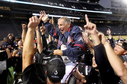 The Atlanta Braves lift manager Bobby Cox after they clinched the National League wild card Sunday, Oct. 3, 2010 in Atlanta. Cox plans to retire after the season.  &#40;AP Photo&#47;John Bazemore&#41; <span class=meta>(AP Photo&#47; John Bazemore)</span>