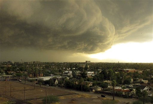 Storm clouds carrying heavy rain move across downtown Phoenix, Tuesday afternoon, Oct. 5, 2010. A series of powerful thunderstorms hit the area with high winds, hail and heavy rain. &#40;AP Photo&#47;Tom Stathis&#41; <span class=meta>(AP Photo&#47; Tom Stathis)</span>