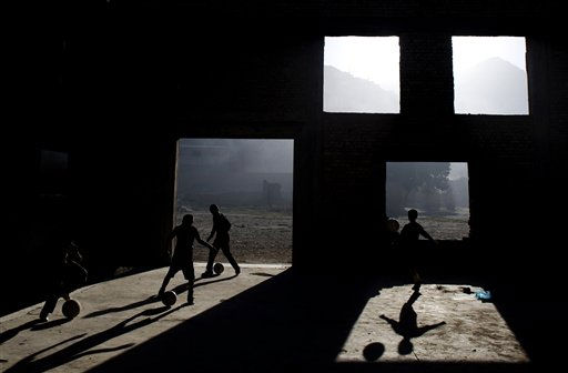 Afghan children play soccer in a house destroyed during the 1990s civil war in Kabul, Afghanistan, Tuesday, Oct. 5, 2010. &#40;AP Photo&#47;Hossein Fatemi&#41; <span class=meta>(AP Photo&#47; Hossein Fatemi)</span>