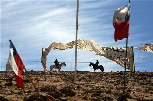 "<div class=""meta ""><span class=""caption-text "">Police on horseback patrol near Chilean flags flying at the San Jose Mine near Copiapo, Chile, Tuesday Oct. 5, 2010.  Chile's President Sebastian Pinera announced that his government is very close to pulling 33 miners to safety after they became trapped on Aug. 5 in the collapsed gold and copper mine. (AP Photo/Dario Lopez-Mills) (AP Photo/ Dario Lopez-Mills)</span></div>"