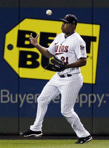 Minnesota Twins&#39; Delmon Young tries to find the handle on a single by New York Yankees&#39; Derek Jeter during the third inning of Game 1 of baseball&#39;s American League Division Series on Wednesday, Oct. 6, 2010, in Minneapolis. &#40;AP Photo&#47;Charlie Neibergall&#41; <span class=meta>(AP Photo&#47; Charlie Neibergall)</span>