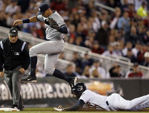 New York Yankees third baseman Alex Rodriguez leaps over Minnesota Twins&#39; Orlando Hudson as Hudson slides safely into third base during the third inning of Game 1 of baseball&#39;s American League Division Series on Wednesday, Oct. 6, 2010, in Minneapolis. Hudson advanced from first on a ball hit by Joe Mauer. &#40;AP Photo&#47;Charlie Neibergall&#41; <span class=meta>(AP Photo&#47; Charlie Neibergall)</span>