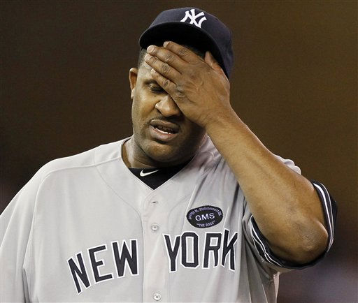 New York Yankees starting pitcher CC Sabathia wipes his forehead during the fifth inning of Game 1 of baseball&#39;s American League Division Series against the Minnesota Twins on Wednesday, Oct. 6, 2010, in Minneapolis. &#40;AP Photo&#47;Charlie Neibergall&#41; <span class=meta>(AP Photo&#47; Charlie Neibergall)</span>