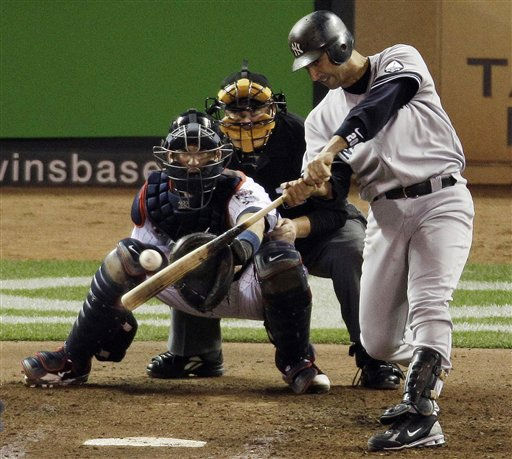 "<div class=""meta ""><span class=""caption-text "">New York Yankees' Jorge Posada hits a run-scoring single during the sixth inning of Game 1 of baseball's American League Division Series against the Minnesota Twins on Wednesday, Oct. 6, 2010, in Minneapolis. (AP Photo/Paul Battaglia) (AP Photo/ Paul Battaglia)</span></div>"