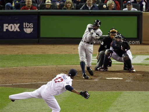 New York Yankees&#39; Curtis Granderson hits a two-run triple off Minnesota Twins starting pitcher Francisco Liriano &#40;47&#41; during the sixth inning of Game 1 of baseball&#39;s American League Division Series on Wednesday, Oct. 6, 2010, in Minneapolis. &#40;AP Photo&#47;Paul Battaglia&#41; <span class=meta>(AP Photo&#47; Paul Battaglia)</span>