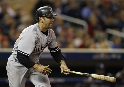 New York Yankees&#39; Jorge Posada hits a single during the sixth inning of Game 1 of the American League Division baseball series against the Minnesota Twins Wednesday, Oct. 6, 2010, in Minneapolis. &#40;AP Photo&#47;Charlie Neibergall&#41; <span class=meta>(AP Photo&#47; Charlie Neibergall)</span>