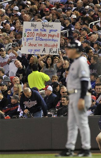 Fans hold a sign during the sixth inning of Game 1 of the American League Division baseball series between the Minnesota Twins and the New York Yankees Wednesday, Oct. 6, 2010, in Minneapolis. &#40;AP Photo&#47;Jim Mone&#41; <span class=meta>(AP Photo&#47; Jim Mone)</span>