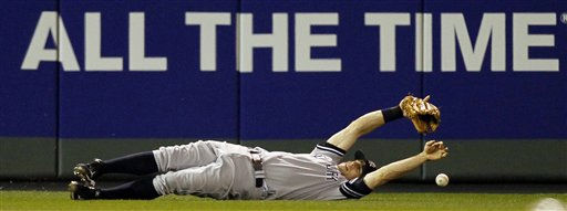 New York Yankees left fielder Brett Gardner can&#39;t come up with a double by Minnesota Twins&#39; Michael Cuddyer during the sixth inning of Game 1 of baseball&#39;s American League Division Series on Wednesday, Oct. 6, 2010, in Minneapolis. &#40;AP Photo&#47;Charlie Neibergall&#41; <span class=meta>(AP Photo&#47; Charlie Neibergall)</span>