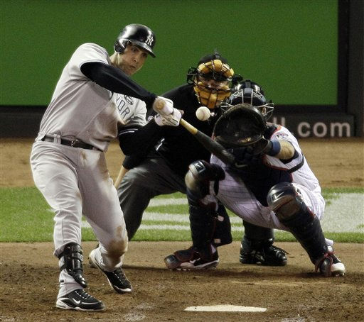 New York Yankees&#39; Mark Teixeira hits a two-run home run during the seventh inning of Game 1 of baseball&#39;s American League Division Series against the Minnesota Twins on Wednesday, Oct. 6, 2010, in Minneapolis. &#40;AP Photo&#47;Paul Battaglia&#41; <span class=meta>(AP Photo&#47; Paul Battaglia)</span>