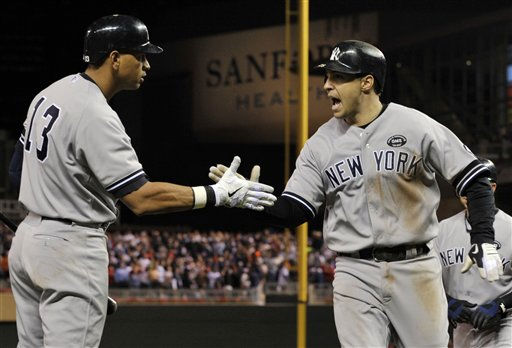 New York Yankees&#39; Alex Rodriguez &#40;13&#41; congratulates Mark Teixeira after Teixeira hit a two-run home run during the seventh inning against the Minnesota Twins in Game 1 of baseball&#39;s American League Division Series on Wednesday, Oct. 6, 2010, in Minneapolis. &#40;AP Photo&#47;Jim Mone&#41; <span class=meta>(AP Photo&#47; Jim Mone)</span>