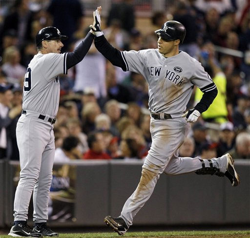 New York Yankees third base coach Rob Thomson congratulates Mark Teixeira, right, as he rounds the bases on a two-run home run during the seventh inning of Game 1 of baseball&#39;s American League Division Series against the Minnesota Twins on Wednesday, Oct. 6, 2010, in Minneapolis. &#40;AP Photo&#47;Charlie Neibergall&#41; <span class=meta>(AP Photo&#47; Charlie Neibergall)</span>