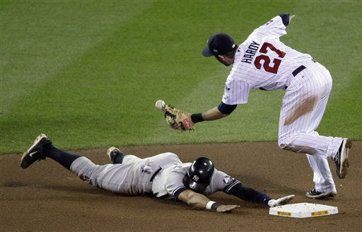 New York Yankees&#39; Alex Rodriguez steals second with Minnesota Twins shortstop J.J. Hardy &#40;27&#41; covering during the seventh inning of Game 1 of baseball&#39;s American League Division Series on Wednesday, Oct. 6, 2010, in Minneapolis. &#40;AP Photo&#47;Paul Battaglia&#41; <span class=meta>(AP Photo&#47; Paul Battaglia)</span>