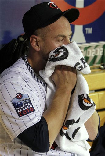 Minnesota Twins relief pitcher Jesse Crain covers his face in the dugout after giving up a two-run home run to New York Yankees&#39; Mark Teixeira during the seventh inning of Game 1 of baseball&#39;s American League Division Series on Wednesday, Oct. 6, 2010, in Minneapolis. &#40;AP Photo&#47;Charlie Neibergall&#41; <span class=meta>(AP Photo&#47; Charlie Neibergall)</span>