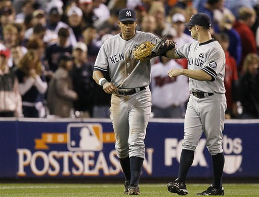 New York Yankees&#39; Alex Rodriguez, left, and Brett Gardner celebrate after Game 1 of baseball&#39;s American League Division Series against the Minnesota Twins on Wednesday, Oct. 6, 2010, in Minneapolis. The Yankees won 6-4. &#40;AP Photo&#47;Charlie Neibergall&#41; <span class=meta>(AP Photo&#47; Charlie Neibergall)</span>