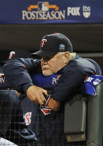 "<div class=""meta ""><span class=""caption-text "">Minnesota Twins manager Ron Gardenhire watches from the dugout during the ninth inning of Game 1 of the American League Division baseball series against the New York Yankees Wednesday, Oct. 6, 2010, in Minneapolis. The Yankees won 6-4 to take a 1-0 lead in the series. (AP Photo/Jim Mone) (AP Photo/ Jim Mone)</span></div>"