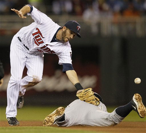 New York Yankees&#39; Alex Rodriguez steals second with Minnesota Twins shortstop J.J. Hardy &#40;27&#41; covering during the seventh inning of Game 1 of the American League Division baseball series Wednesday, Oct. 6, 2010, in Minneapolis. &#40;AP Photo&#47;Charlie Neibergall&#41; <span class=meta>(AP Photo&#47; Charlie Neibergall)</span>