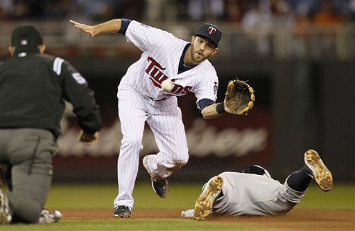 "<div class=""meta ""><span class=""caption-text "">New York Yankees' Alex Rodriguez steals second with Minnesota Twins shortstop J.J. Hardy (27) covering during the seventh inning of Game 1 of the American League Division baseball series Wednesday, Oct. 6, 2010, in Minneapolis. (AP Photo/Charlie Neibergall) (AP Photo/ Charlie Neibergall)</span></div>"