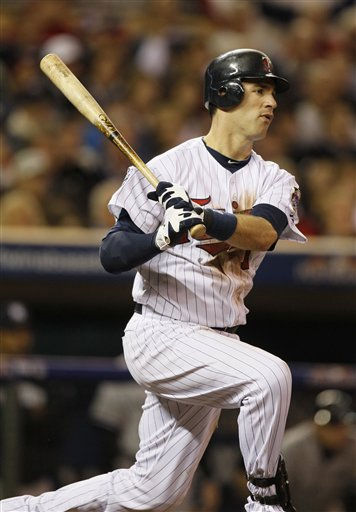 Minnesota Twins&#39; Joe Mauer hits a single during the seventh inning of Game 1 of the American League Division baseball series against the New York Yankees Wednesday, Oct. 6, 2010, in Minneapolis. &#40;AP Photo&#47;Charlie Neibergall&#41; <span class=meta>(AP Photo&#47; Charlie Neibergall)</span>