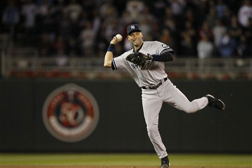 New York Yankees shortstop Derek Jeter makes a play on a ball hit by Minnesota Twins&#39; Denard Span during the eighth inning of Game 1 of the American League Division baseball series Wednesday, Oct. 6, 2010, in Minneapolis. &#40;AP Photo&#47;Charlie Neibergall&#41; <span class=meta>(AP Photo&#47; Charlie Neibergall)</span>