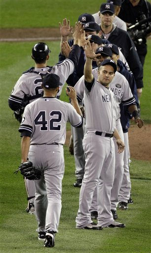 The New York Yankees celebrate after Game 1 of the American League Division baseball series against the Minnesota Twins Wednesday, Oct. 6, 2010, in Minneapolis. The Yankees won 6-4 to take a 1-0 lead in the series. &#40;AP Photo&#47;Paul Battaglia&#41; <span class=meta>(AP Photo&#47; Paul Battaglia)</span>