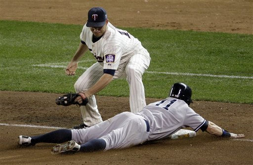 Minnesota Twins third baseman Danny Valencia applies a late tag as New York Yankees&#39; Brett Gardner &#40;11&#41; steals third during the ninth inning of Game 2 of baseball&#39;s American League Division Series,  Thursday, Oct. 7, 2010, in Minneapolis. &#40;AP Photo&#47;Paul Battaglia&#41; <span class=meta>(AP Photo&#47; Paul Battaglia)</span>
