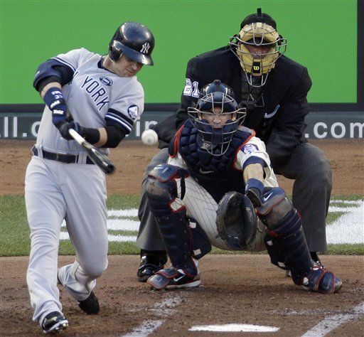 Minnesota Twins catcher Joe Mauer watches as New York Yankees&#39; Nick Swisher hits a double during the second inning of Game 2 of baseball&#39;s American League Division series Thursday, Oct. 7, 2010, in Minneapolis. The home plate umpire is Hunter Wednelstedt. &#40;AP Photo&#47;Paul Battaglia&#41; <span class=meta>(AP Photo&#47; Paul Battaglia)</span>