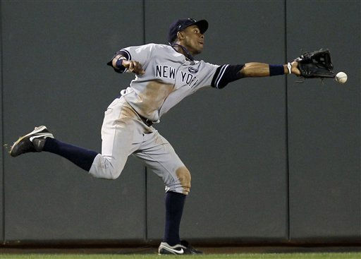 New York Yankees center fielder Curtis Granderson &#40;14&#41; can&#39;t come up with a triple off hit by Minnesota Twins&#39; Delmon Young during the sixth inning of Game 2 of baseball&#39;s American League Division Series,  Thursday, Oct. 7, 2010, in Minneapolis. &#40;AP Photo&#47;Charlie Neibergall&#41; <span class=meta>(AP Photo&#47; Charlie Neibergall)</span>