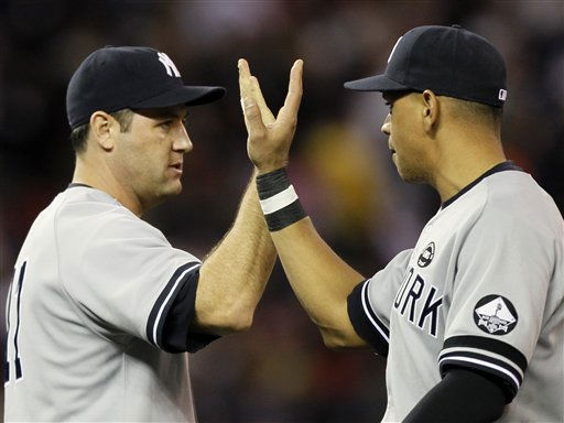 New York Yankees&#39;  Lance Berkman, left,  and Alex Rodriguez celebrate after Game 2 of baseball&#39;s American League Division Series against the Minnesota Twins,  Thursday, Oct. 7, 2010, in Minneapolis. The Yankees won 5-2 to take a 2-0 lead in the series. &#40;AP Photo&#47;Charlie Neibergall&#41; <span class=meta>(AP Photo&#47; Charlie Neibergall)</span>