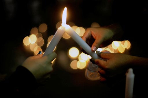 "<div class=""meta ""><span class=""caption-text "">People light candles at the place where college student Lucila Quintanilla was killed in Monterrey, Mexico, Thursday, Oct. 7, 2010. Quintanilla was shot to death accidentally Wednesday as she was walking in downtown Monterrey when unknown gunmen opened fire. (AP Photo/Carlos Jasso) (AP Photo/ Carlos Jasso)</span></div>"