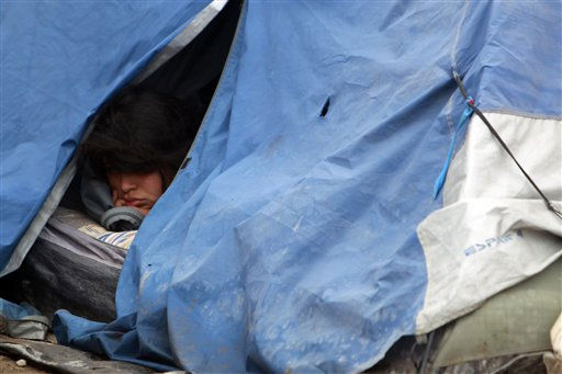 "<div class=""meta ""><span class=""caption-text "">An unidentified relative of a trapped miner sleeps in a tent at the San Jose mine, Copiapo, Chile Friday, Oct. 8, 2010. Chile's mining minister says that just 130 feet, some 39 meters, remain before a drill breaks through to reach the chamber in the collapsed gold and copper mine where 33 trapped miners have waited more than two months to be rescued. (AP Photo/Natacha Pisarenko) (AP Photo/ Natacha Pisarenko)</span></div>"