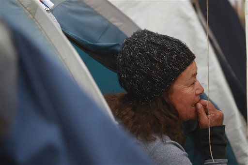 "<div class=""meta ""><span class=""caption-text "">Elizabeth Segovia, sister of trapped miner Dario Segovia, sits a the camp where relatives wait for the rescue of the miners outside the San Jose mine, Copiapo, Chile, Friday, Oct. 8, 2010. Chile's mining minister says that just 130 feet (39 meters) remain before a drill breaks through to reach the chamber in the collapsed gold and copper mine where 33 trapped miners have waited more than two months to be rescued. (AP Photo/Natacha Pisarenko) (AP Photo/ Natacha Pisarenko)</span></div>"