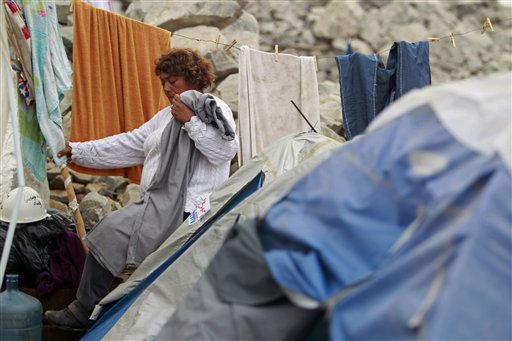 "<div class=""meta ""><span class=""caption-text "">A woman leaves her tent a the camp where relatives wait for the rescue of trapped miners outside the San Jose mine, Copiapo, Chile, Friday, Oct. 8, 2010. Chile's mining minister says that just 130 feet (39 meters) remain before a drill breaks through to reach the chamber in the collapsed gold and copper mine where 33 trapped miners have waited more than two months to be rescued. (AP Photo/Natacha Pisarenko) (AP Photo/ Natacha Pisarenko)</span></div>"