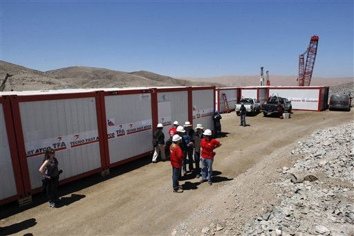 Chilean government authorities stand outside of modules set up for the initial reunion between rescued miners with their relatives at the San Jose Mine near Copiapo, Chile Friday, Oct. 8, 2010. Engineers and rescue workers continue working to get to the 33 trapped miners who have waited for more than two months to be rescued.&#40;AP Photo&#47;Juan Eduardo Lopez, El Mercurio, pool&#41; <span class=meta>(AP Photo&#47; Juan Eduardo Lopez)</span>