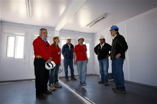 "<div class=""meta ""><span class=""caption-text "">Chile's Health Minister Jaime Manalich, left, Atacama region mining official Ximena Matas, second from left, and Chile's Minister of Mining, Laurence Golborne, center, inspect a module that will be used for the initial reunion between rescued miners with their relatives at the San Jose Mine near Copiapo, Chile Friday, Oct. 8, 2010. Engineers and rescue workers continue working to get to the 33 trapped miners who have waited for more than two months to be rescued. Other people in the photo are unidentified. (AP Photo/Juan Eduardo Lopez, El Mercurio, pool) (AP Photo/ Juan Eduardo Lopez)</span></div>"