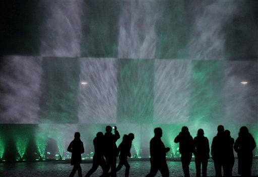 People are silhouetted as they watch a night fountain show with color lights near the Centennial  Hall in Wroclaw, Poland, Thursday, Oct. 7, 2010.&#40;AP Photo&#47;Alik Keplicz&#41; <span class=meta>(AP Photo&#47; Alik Keplicz)</span>