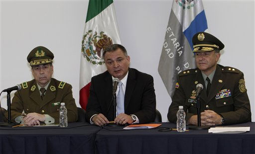 "<div class=""meta ""><span class=""caption-text "">Chile's Police Gen. Gerardo Gonzalez, left, Mexico's Secretary of Public Safety Genaro Garcia Luna, center, and Colombia's Police Chief Gen. Oscar Naranjo Trujillo attend a press conference on the sidelines of an American Police Community (Ameripol) meeting in Mexico City, Friday Oct. 8, 2010. (AP Photo/Marco Ugarte) (AP Photo/ Marco Ugarte)</span></div>"