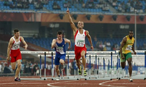 "<div class=""meta image-caption""><div class=""origin-logo origin-image ""><span></span></div><span class=""caption-text"">England's Andy Turner, second from right, reacts as he crosses the finish line ahead of England's Lawrence Clarke, left, Scotland's Chris Baillie, second from left, and Jamaica's Eric Keddo Men's 110m Hurdles final during the Commonwealth Games at the Jawaharlal Nehru Stadium in New Delhi, India, Friday, Oct. 8, 2010. (AP Photo/Anja Niedringhaus) (AP Photo/ Anja Niedringhaus)</span></div>"