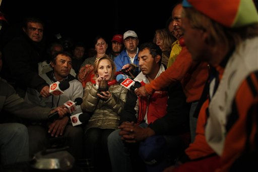 Chile&#39;s First Lady Cecilia Morel, center, drinks mate, an herbal tea, as she meets with the relatives of trapped miners at a camp near at the San Jose mine in Copiapo, Chile, Friday Oct. 8, 2010. Drillers neared the lower reaches of a gold and copper mine where 33 men have been trapped for more than two months, preparing Friday for a breakthrough. The mine collapsed on Aug. 5. &#40;AP Photo&#47;Natacha Pisarenko&#41; <span class=meta>(AP Photo&#47; Natacha Pisarenko)</span>
